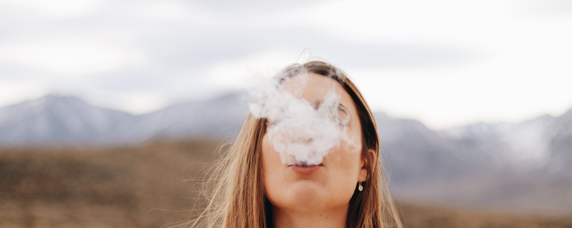 HeyHelloHigh stoner girl smoking near mountains